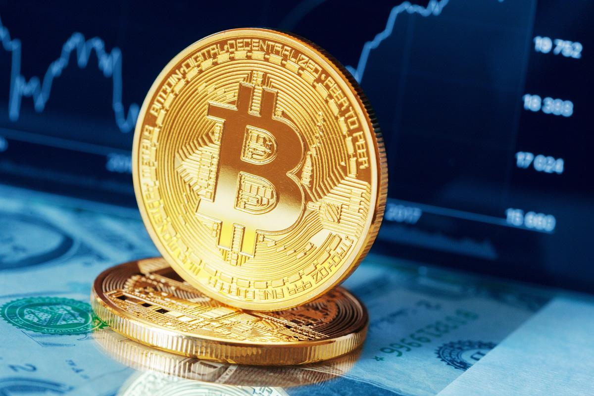 الى من ينسب انشاء عملة bitcoin